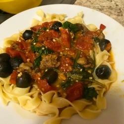 Greek Lamb Over Noodles on plate