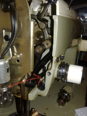 Replacing the Thread Tension Assembly on My Old Kenmore 158 - inside of the machine with arrow pointing to the area in question