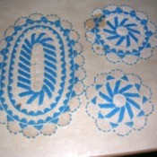 Cleaning Stains on Beaded Crochet Items - white crochet doilies and oval mat with blue seed beading