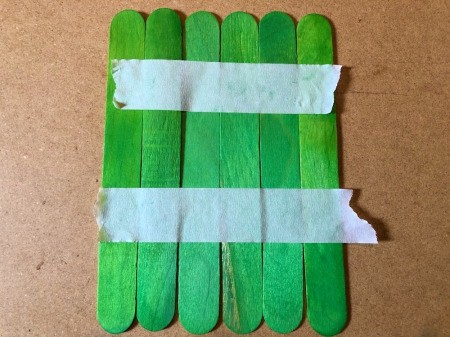 Halloween Craft Stick Puzzles - tape green craft sticks together
