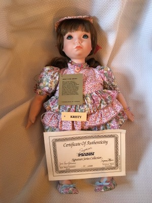 Value of a Seymour Mann Porcelain Doll - doll with certificate, name tag, and tag with info about the artist