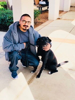 New Dog Not Going to the Bathroom or Eating - man with a black Lab mix
