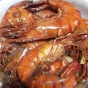 cooked unpeeled Garlic Butter Shrimp on plate