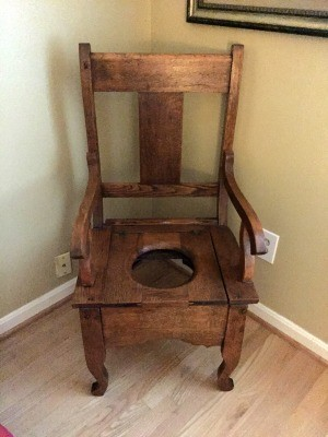 An old wooden potty chair.