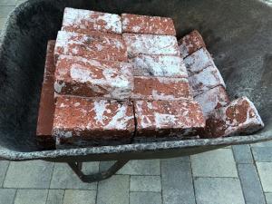A wheelbarrow of bricks.