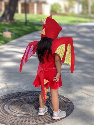 Toddler Girl's Dragon Halloween Costume - young girl dressed as a dragon