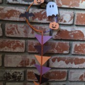 Hanging Halloween Themed Hoop Decoration - finished decoration hanging on brick fireplace