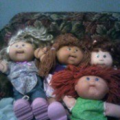 Selling Cabbage Patch Dolls - 4 dolls on a couch
