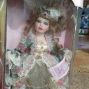 Value of Porcelain Dolls - doll in a box, wearing a glittery ball gown, Collectible Memories