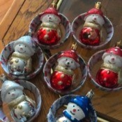 Handcrafted Christmas Ornaments - several ornaments lying on a table