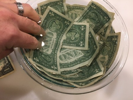 Cold Hard Cash Gift - arranging the bills around the inside of the bowl