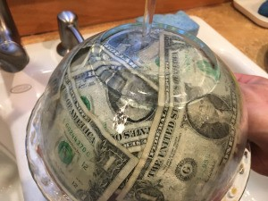 Cold Hard Cash Gift - once frozen, to give to the recipient, run the bowl under warm water to release the ice clock
