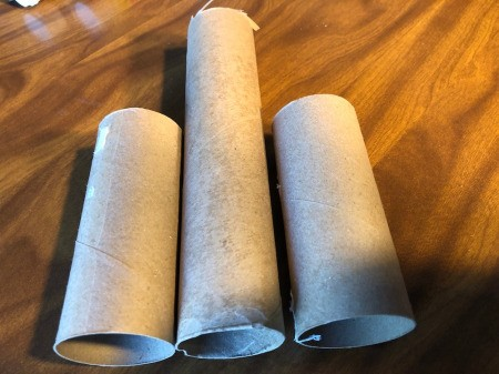 Cardboard Tube Haunted House - place a TP tube on each side of a paper towel tube, trim the towel tube down a bit