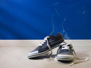 Blue canvas tennis shoes steaming.