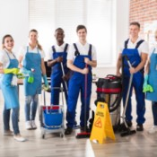 Group of cleaners wearing aprons.