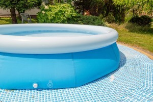 A blue above ground swimming pool.