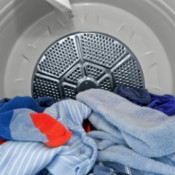 Blue clothes in a dryer