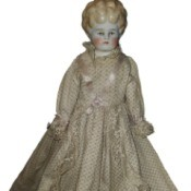 Identifying a Porcelain Doll - white porcelain doll with molded hair and long lace trimmed dress