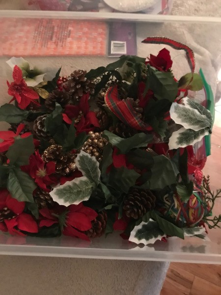 Poinsettia Wreath - plastic box with flowers, leaves, and pine cones