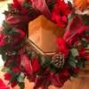 Poinsettia Wreath - finished wreath on edge of a table