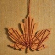 Yarn Embellished Wooden Maple Leaf - finished leaf hanging on the wall
