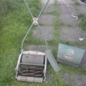 Value of a Ransones Antique Reel Lawn Mower - old grey mower with an X shaped handle