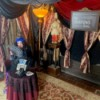 Fortune Teller Costume - woman dressed as a fortune teller with drapes and other decorations