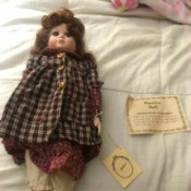 Value of a Doll from the Emerald Doll Collection - doll lying on a bed