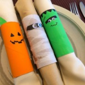 Cardboard Halloween Napkin Rings - completed napkin rings lying across a plate