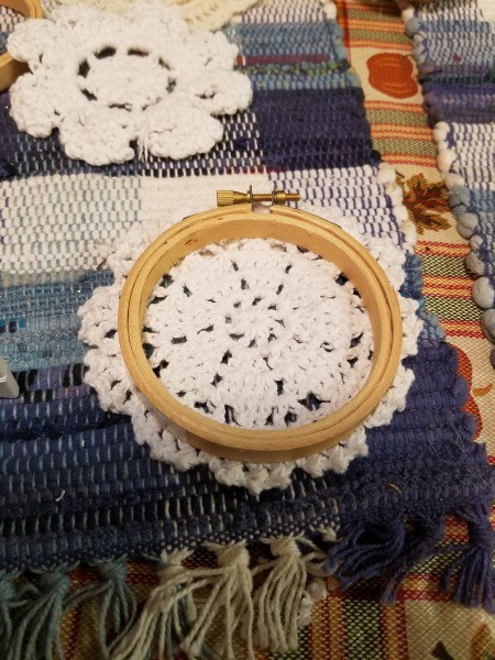 Embroidery Hoop Doily Wall Decoration - hoop sitting on top of a different commercial doily