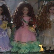 Identifying Porcelain Dolls - three dolls with long curly hair