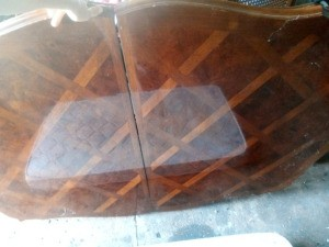 Value of a Teak Table - table with a mattress reflected in it