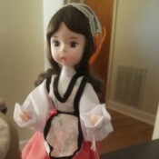 Value of a Bradly Porcelain Doll - doll in native dress