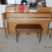 Value of a Story and Clark Upright Piano - light wood piano