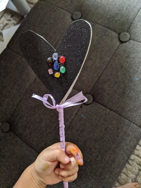 Fancy Costume Wand - child's hand holding the lavender wand