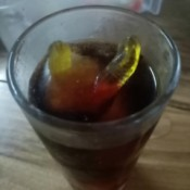 Worm Ice Cubes - dark soda with gummy worm ice cube