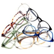 A collection of eyeglasses on a white background.
