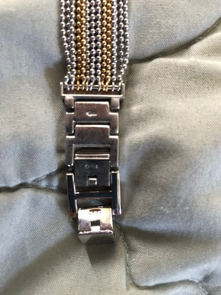 Shortening a Watch Band with Links  - turn band inside out, look for links with an arrow