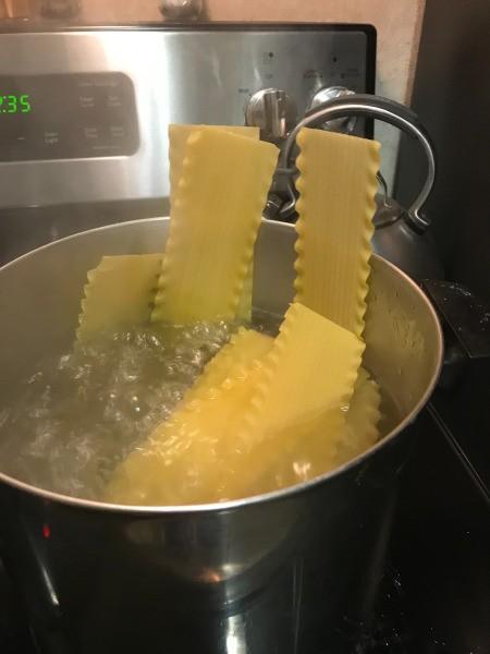 Lasagna in pan of boiling water