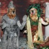A dog dressed as Medusa and another dressed as a soldier being turned to stone.