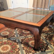 Value of an Opium Leg Coffee Table - table with four glass inserts and distinctive curved legs