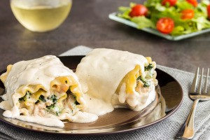 Lasagna noodle rolls with savory filling.