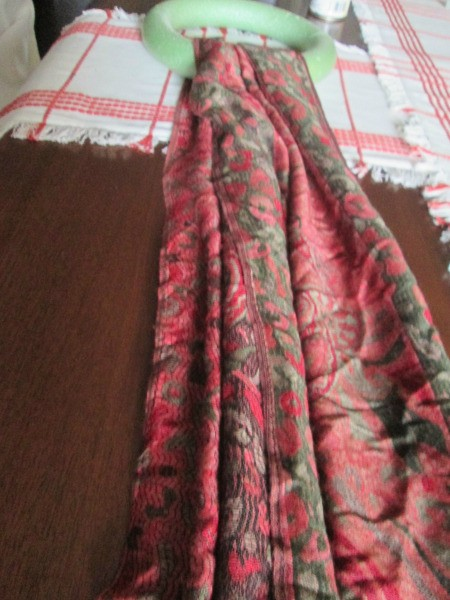 Making Winter Scarf Covered Wreaths - red and green print scarf looped over foam wreath form