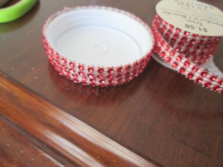 Budget Friendly Snow Globe - small red jewel tape attached around the base