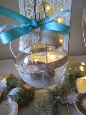 Coastal Beach Ornaments - closeup of a filled ball with blue box, and snowflake ribbon around the center