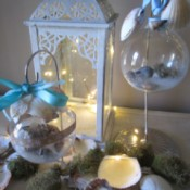 Coastal Beach Ornaments - two decorated ornaments hanging on stands