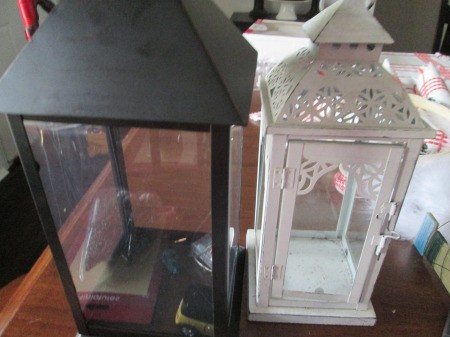 Making A Lantern Part Of Your Holiday Decor - a black and a white decorative lantern