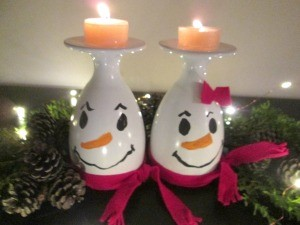 Drinking Glass Candle Holders - snowpeople with lit candles
