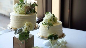 Adding Fresh Flowers to Cake Decoration - two small wedding cakes decorated with fresh flowers