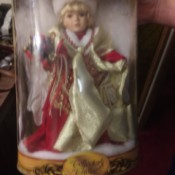 Value of a Collector's Choice Porcelain Doll - Christmas doll in the plastic box